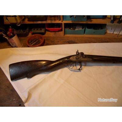 Ancien fusil de chasse à percussion.