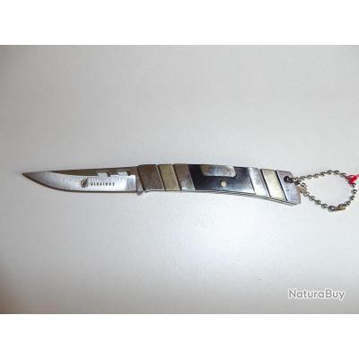 porte cl s couteau design porte cl s 1835738. Black Bedroom Furniture Sets. Home Design Ideas