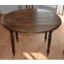 Table ronde ancienne en noyer massif.