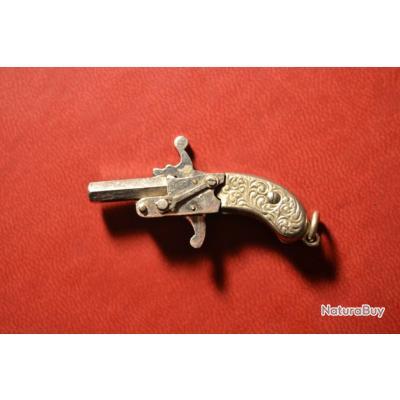 Joli pistolet miniature 2mm à broche crosse argent en parfait état de marche