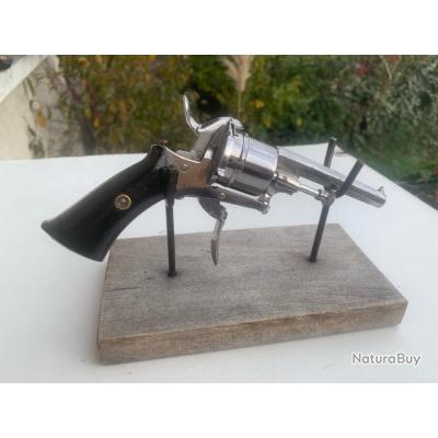 Revolver a broche canon a pan crosse en bois